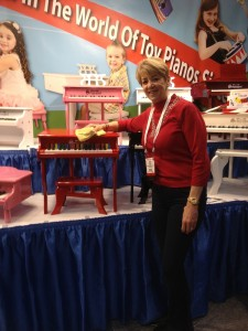 Renee Trinca, co-owner of Schoenhut Piano Company, at Toy Fair 2013 in NYC.